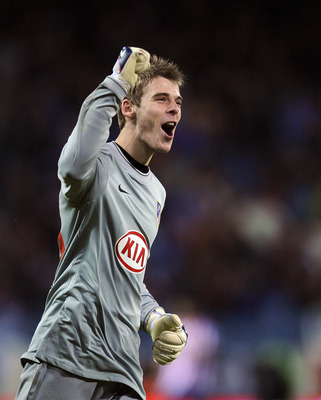 MADRID, SPAIN - FEBRUARY 04:  David de Gea of Atletico Madrid celebrates after his side scored their fourth goal against Racing Santander during the Copa del Rey semi-final, first leg match between Atletico Madrid and Racing Santander at the Vicente Calde