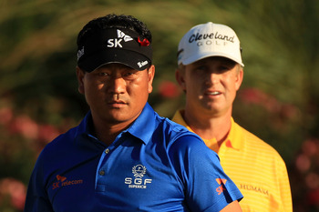 PONTE VEDRA BEACH, FL - MAY 15:  K.J. Choi of South Korea (L) and David Toms (R) look on from the 18th tee box during the final round of THE PLAYERS Championship held at THE PLAYERS Stadium course at TPC Sawgrass on May 15, 2011 in Ponte Vedra Beach, Flor