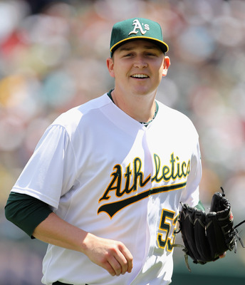 OAKLAND, CA - MAY 15:  Trevor Cahill #53 of the Oakland Athletics jogs off the field after a double play ended the third inning of their game against the Chicago White Sox at Oakland-Alameda County Coliseum on May 15, 2011 in Oakland, California.  (Photo