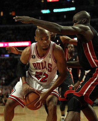 CHICAGO, IL - FEBRUARY 24: Taj Gibson #22 of the Chicago Bulls moves against Joel Anthony #50 of the Miami Heat at the United Center on February 24, 2011 in Chicago, Illinois. The Bulls defeated the Heat 93-89. NOTE TO USER: User expressly acknowledges an