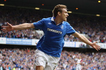 GLASGOW, SCOTLAND - MAY 07:  Nikica Jelavic of Rangers celebrates after scoring during the Clydesdale Bank Premier League match between Rangers and Hearts at Ibrox Stadium on May 7, 2011 in Glasgow, Scotland.(Photo by Jeff J Mitchell/Getty Images)