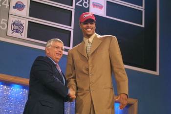 27 Jun 2001:  NBA Commisioner David Stern congratulates Tyson Chandler of Dominguez High School in Compton, California on being the second pick in the NBA Draft by the Los Angeles Clippers at the Theatre in Madison Square Garden in New York City. Mandator