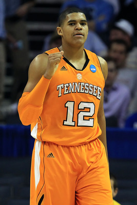 CHARLOTTE, NC - MARCH 18:  Tobias Harris #12 of the Tennessee Volunteers reacts in the first half while taking on the Michigan Wolverines during the second round of the 2011 NCAA men's basketball tournament at Time Warner Cable Arena on March 18, 2011 in