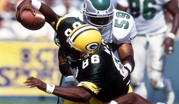 Seth Joyner (Philadelphia Eagles) is stopped by the combined efforts of Ed West (86) and William Frizzell, during the Eagles 20-17 win over the Green Bay Packers. Mandatory Credit: Jonathan Daniel/ALLSPORT