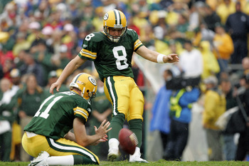 GREEN BAY, WI - SEPTEMBER 25:  Ryan Longwell #8 of the Green Bay Packers kicks during the game with the Tampa Bay Buccaneers on September 25, 2005 at Lambeau Field in Green Bay, Wisconsin.  The Bucs won 17-16.  (Photo by Brian Bahr/Getty Images)
