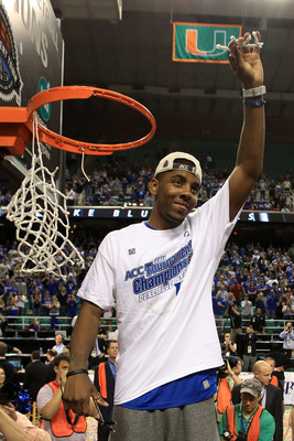 GREENSBORO, NC - MARCH 13:  Kyrie Irving #1 of the Duke Blue Devils cuts down the net after defeating the North Carolina Tar Heels 75-58 in the championship game of the 2011 ACC men's basketball tournament at the Greensboro Coliseum on March 13, 2011 in G