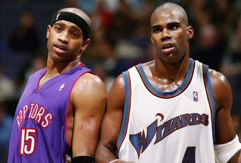 WAHINGTON DC - NOVEMBER 23:  Antawn Jamison #4 of the Washington Wizards and Vince Carter #15 of the Toronoto Raptors talk during a free throw as the Wizards defeated the Raptors 102-86 November 23, 2004 at the MCI Center in Washington D.C.  NOTE TO USER: