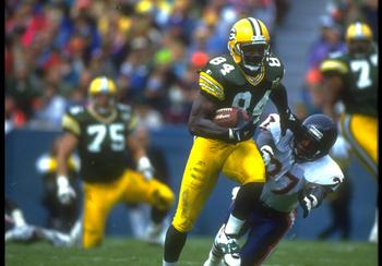 31 OCT 1993:  GREEN BAY PACKERS WIDE RECEIVER STERLING SHARPE GIVES A STRAIGHT ARM TO AN UNIDENTIFIED CHICAGO BEARS DEFENSEMAN DURING THE PACKERS 17-3 WIN AT LAMBEAU FIELD IN CHICAGO, ILLINOIS.  MANDATORY CREDIT:  JONATHAN DANIEL/ALLSPORT