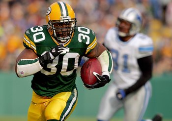 GREEN BAY, WI - DECEMBER 17:  Ahman Green #30 of the Green Bay Packers carries the ball against the Detroit Lions on December 17, 2006 at Lambeau Field in Green Bay, Wisconsin. The Packers defeated the Lions 17-9.  (Photo by Matthew Stockman/Getty Images)