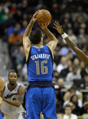 WASHINGTON, DC - FEBRUARY 26: Peja Stojakovic #16 of the Dallas Mavericks puts up a shot agaisnt the Washington Wizards at the Verizon Center on February 26, 2011 in Washington, DC. NOTE TO USER: User expressly acknowledges and agrees that, by downloading