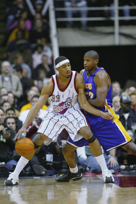 HOUSTON - JANUARY 17:  Eddie Griffin #33 of the Houston Rockets is defended by Samake Walker #52 of the Los Angeles Lakers during the game at Compaq Center on January 17, 2003 in Houston, Texas.  The Rockets won in overtime 108-104.  NOTE TO USER: User ex