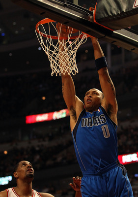 CHICAGO, IL - JANUARY 20: Shawn Marion #0 of the Dallas Mavericks dunks the ball over Kurt Thomas #40 of the Chicago Bulls at the United Center on January 20, 2011 in Chicago, Illinois. NOTE TO USER: User expressly acknowledges and agrees that, by downloa