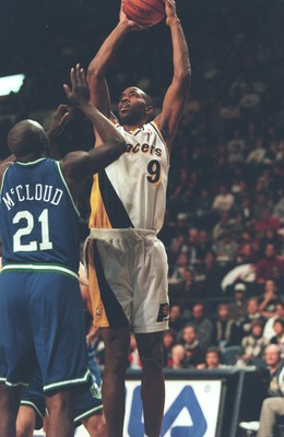 22 Dec 1995:  Derrick McKey #9 of the Indiana Pacers tries to shoot over George McCloud of the Dallas Mavericks in the game at the Market Square Arena in Indianapolis, Indiana.     Mandatory Credit: Allsport USA/Allsport
