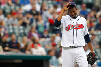 CLEVELAND - MAY 13:  Fausto Carmona #55 of the Cleveland Indians takes a moment to himself before pitching against the Seattle Mariners during the game on May 13, 2011 at Progressive Field in Cleveland, Ohio.  (Photo by Jared Wickerham/Getty Images)