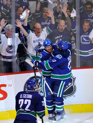 VANCOUVER, BC - MAY 15:  Henrik Sedin #33 of the Vancouver Canucks celebrates with teammate Ryan Kesler #17 after his third period goal against the San Jose Sharks in Game One of the Western Conference Finals during the 2011 Stanley Cup Playoffs at Rogers