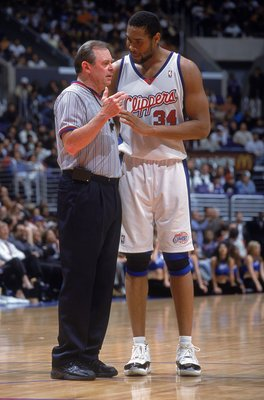 20 Mar 2001:  Michael Olowdokandi #34 of the Los Angeles Clippers talks with a Referee on the court during the game against the Philadelphia 76ers at the STAPLES Center in Los Angeles, California.  The Clippers defeated the 76ers 88-77.    NOTE TO USER: I