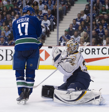 VANCOUVER, CANADA - APRIL 30: Ryan Kesler #17 of the Vancouver Canucks watches goalie Pekka Rinne #35 of the Nashville Predators make a glove save during the second period in Game Two of the Western Conference Semifinals during the 2011 NHL Stanley Cup Pl