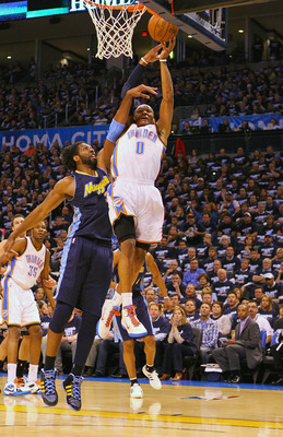 OKLAHOMA CITY, OK - APRIL 27: Russell Westbrook #0 of the Oklahoma City Thunder attempts to dunk the ball against Nene Hilario #31 of the Denver Nuggets in Game Five of the Western Conference Quarterfinals in the 2011 NBA Playoffs on April 27, 2011 at the