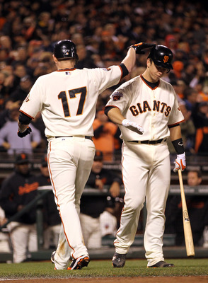 SAN FRANCISCO, CA - MAY 11:  Aubrey Huff #17 of the San Francisco Giants is congratulated by Buster Posey #28 of the San Francisco Giants after Huff hit a home run to tie the game against the Arizona Diamondbacks in the fifth inning at AT&T Park on May 11