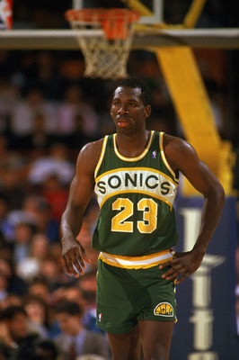 LOS ANGELES - 1990:  Olden Polynice #23 of the Seattle Supersonics walks on the court during a game against the Los Angeles Lakers in the 1989-1990 NBA season at the Great Western Forum in Los Angeles, California.  (Photo by Ken Levine/Getty Images)