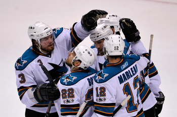 VANCOUVER, CANADA - MAY 15:  Douglas Murray #3, Dan Boyle #22, Devin Setoguchi #16 and Patrick Marleau #12 of the San Jose Shars congratulate Joe Thornton #19 after Thornton scored against the Vancouver Canucks in the first period in Game One of the Weste