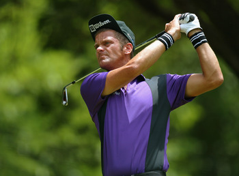 FT. WORTH, TX - MAY 23:  Jesper Parnevik hits a shot during the final round of the Bank of America Colonial at the Colonial Country Club on May 23, 2004 in Ft. Worth, Texas.  (Photo by Jonathan Ferrey/Getty Images)