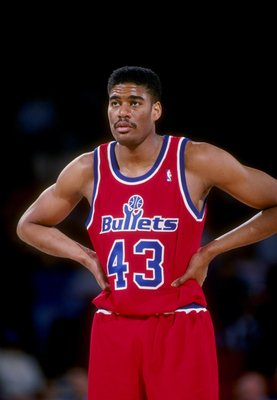 1993:  Center Pervis Ellison of the Washington Bullets stands on the court during a game against the Denver Nuggets at the McNichols Sports Arena in Denver, Colorado.   Mandatory Credit: Tim de Frisco  /Allsport