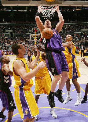 LOS ANGELES - DECEMBER 28:  Rafael Araujo #55 of the Toronto Raptors slams over Chris Mihm #31 of the Los Angeles Lakers on December 28, 2004 at Staples Center in Los Angeles, California. The Lakers won 117-99.  NOTE TO USER: User expressly acknowledges a