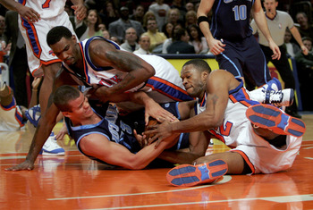 NEW YORK - DECEMBER 23:  Qyntel Woods #6 and Antonio Davis #32 of the New York Knicks fight for the ball with Kris Humphries #43 of the Utah Jazz on December 23, 2005 at Madison Square Garden in New York City. The Knicks won 98-90. NOTE TO USER: User expr