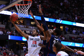 ANAHEIM, CA - MARCH 24:  Kawhi Leonard #15 of the San Diego State Aztecs goes to the hoop against Alex Oriakhi #34 of the Connecticut Huskies during the west regional semifinal of the 2011 NCAA men's basketball tournament at the Honda Center on March 24,