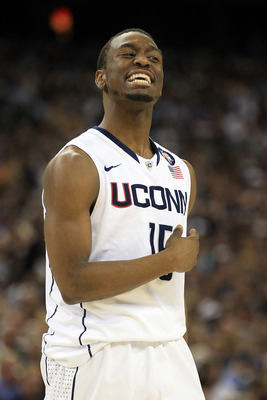 HOUSTON, TX - APRIL 04:  Kemba Walker #15 of the Connecticut Huskies reacts after a play against the Butler Bulldogs during the National Championship Game of the 2011 NCAA Division I Men's Basketball Tournament at Reliant Stadium on April 4, 2011 in Houst