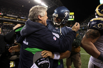 SEATTLE, WA - JANUARY 02:  Head coach Pete Carroll of the Seattle Seahawks hugs quarterback Charlie Whitehurst #6 after defeating the St. Louis Rams 16-6 at Qwest Field on January 2, 2011 in Seattle, Washington. The Seahawks became the first team to advan