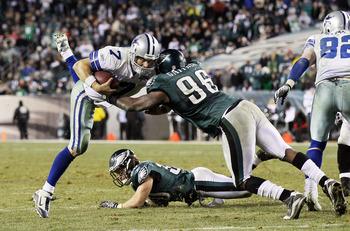 PHILADELPHIA, PA - JANUARY 02:  Stephen McGee #7 of the Dallas Cowboys runs the ball against Omar Gaither #96 of the Philadelphia Eagles on January 2, 2011 at Lincoln Financial Field in Philadelphia, Pennsylvania. The Cowboys defeated the Eagles 14-13.  (