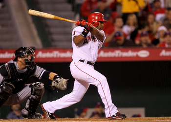ANAHEIM, CA - MAY 11:  Alberto Callaspo #6 of the Los Angeles Angels of Anaheim hits an RBI single in the sixth inning against the Chicago White Sox on May 11, 2011 at Angel Stadium in Anaheim, California.  (Photo by Stephen Dunn/Getty Images)