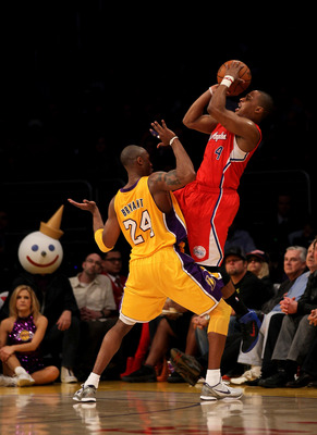 LOS ANGELES, CA - FEBRUARY 25: Randy Foye #4 of the Los Angeles Clippers shoots over Kobe Bryant #24 of the Los Angeles Lakers at Staples Center on February 25, 2011 in Los Angeles, California. The Lakers won 100-88.  NOTE TO USER: User expressly acknowle