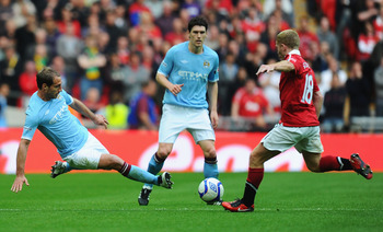 LONDON, ENGLAND - APRIL 16:  Pablo Zabaleta of Manchester City tackles Paul Scholes of Man Utd during the FA Cup sponsored by E.ON semi final match between Manchester City and Manchester United at Wembley Stadium on April 16, 2011 in London, England.  (Ph