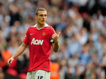 LONDON, ENGLAND - APRIL 16: Nemanja Vidic of Manchester United gestures during the FA Cup sponsored by E.ON semi final match between Manchester City and Manchester United at Wembley Stadium on April 16, 2011 in London, England.  (Photo by Jamie McDonald/G