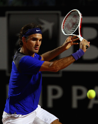 ROME, ITALY - MAY 11:  Roger Federer of Switzerland plays a backhand during his second round match against Jo-Wilfried Tsonga of France during day four of the Internazoinali BNL D'Italia at the Foro Italico Tennis Centre on May 11, 2011 in Rome, Italy.  (
