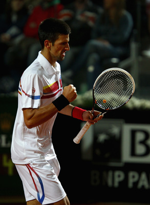 ROME, ITALY - MAY 15:  Novak Djokovic of Serbia celebrates a point in the final against Rafael Nadal of Spain during day eight of the Internazoinali BNL D'Italia at the Foro Italico Tennis Centre on May 15, 2011 in Rome, Italy.  (Photo by Clive Brunskill/