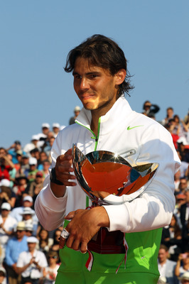 MONACO - APRIL 17:  Rafael Nadal of Spain with the trophy after defeating David Ferrer of Spain in the final during Day Eight of the ATP Masters Series Tennis at the Monte Carlo Country Club on April 17, 2011 in Monte Carlo, Monaco.  (Photo by Julian Finn