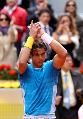 MADRID, SPAIN - MAY 14:  Rafael Nadal of Spain applauds the crowd after his straight sets victory against Gael Monfils of France in their quarter final match during the Mutua Madrilena Madrid Open tennis tournament at the Caja Magica on May 14, 2010 in Ma