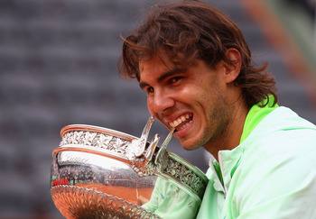 PARIS - JUNE 06:  Rafael Nadal of Spain celebrates with the trophy after winning the men's singles final match between Rafael Nadal of Spain and Robin Soderling of Sweden on day fifteen of the French Open at Roland Garros on June 6, 2010 in Paris, France.