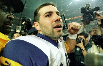 F363722 55: (NORTH AND SOUTH AMERICA SALES ONLY) Quarterback Kurt Warner of the St Louis Rams is escorted off the field after winning Super Bowl XXXIV at the Georgia Dome in Atlanta, Georgia on January 30, 2000. The St. Louis Rams defeated the Tennessee T