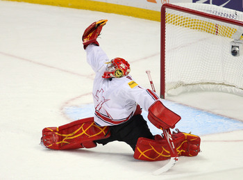 BUFFALO, NY - JANUARY 02: Benjamin Conz #1 of Switzerland makes a glove save against Canada  during the 2011 IIHF World U20 Championship game between Canada and Switzerland on January 2, 2011 in Buffalo, New York.  (Photo by Rick Stewart/Getty Images)