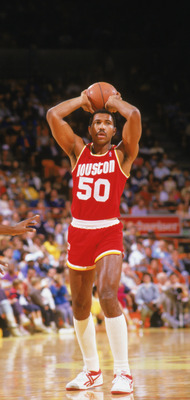INGLEWOOD -1987:  Robert Reid #50 of the Houston Rockets looks to make a pass during a game in the1987-88 season against the Los Angeles Lakers at the Forum in Inglewood, California. NOTE TO USER: User expressly acknowledges and agrees that, by downloadin