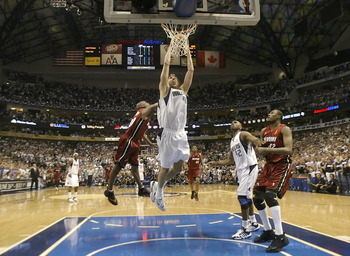 DALLAS - JUNE 20:  Dirk Nowitzki #41 of the Dallas Mavericks slam dunks over Gary Payton #20 of the Miami Heat in game six of the 2006 NBA Finals on June 20, 2006 at American Airlines Center in Dallas, Texas.  The Heat won 95-92 and win the series 4-2.  N