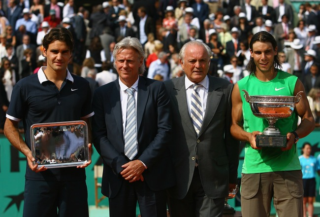 PARIS - JUNE 08:  Roger Federer of Switzerland, Bjorn Borg of Sweden, Christian Bimes of the FFT and Rafael Nadal of Spain pose for photos after the final match between  during the Men's Singles Final match on day fifteen of the French Open at Roland Garr