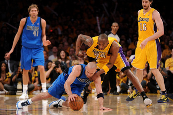 LOS ANGELES, CA - MAY 02:  Jason Kidd #2 of the Dallas Mavericks and Kobe Bryant #24 of the Los Angeles Lakers battle for a loose ball in the third quarter in Game One of the Western Conference Semifinals in the 2011 NBA Playoffs at Staples Center on May