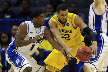 CHARLOTTE, NC - MARCH 20:  Kyrie Irving #1 of the Duke Blue Devils attempts to steal the ball from Jordan Morgan #52 of the Michigan Wolverines in the second half during the third round of the 2011 NCAA men's basketball tournament at Time Warner Cable Are