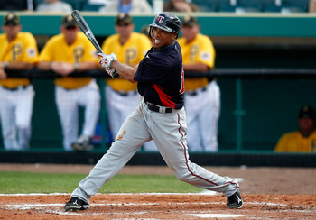BRADENTON, FL - MARCH 02:  Outfielder Ben Revere #11 of the Minnesota Twins fouls off a pitch against the Pittsburgh Pirates during a Grapefruit League Spring Training Game at McKechnie Field on March 2, 2011 in Bradenton, Florida.  (Photo by J. Meric/Get